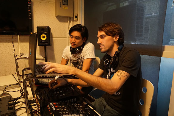 This Picture shows us Digital DJ with Ableton Live InEarBeat Electronic Music Scholl in Thailand. This course provide you how to setup controller and mixer plus how to mash up beats.