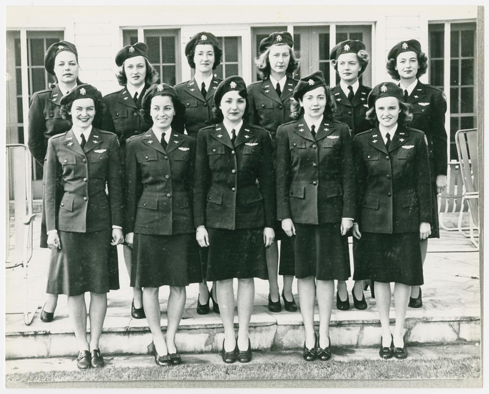 Eleven WASPS pose for their photograph, wearing their Santiago dress blues.
