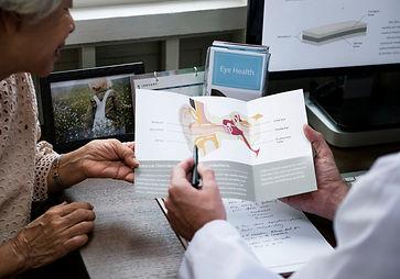 senior woman with doctor - ear care.jpg