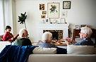 seniors in livingroom discussion.jpg