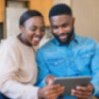 Smiling young African American couple us