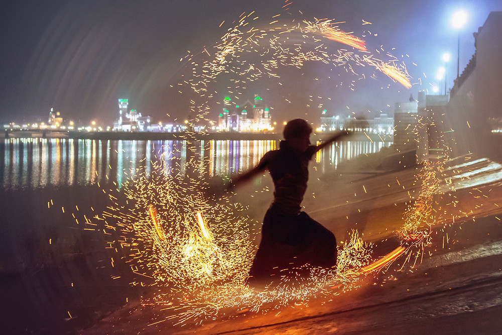 person dancing with fire