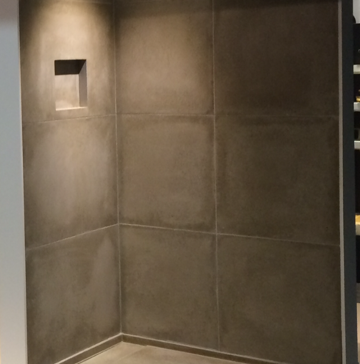 Shower base and sealed wall tiles