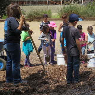 IMG_3331 Marla w kids mulch.jpg
