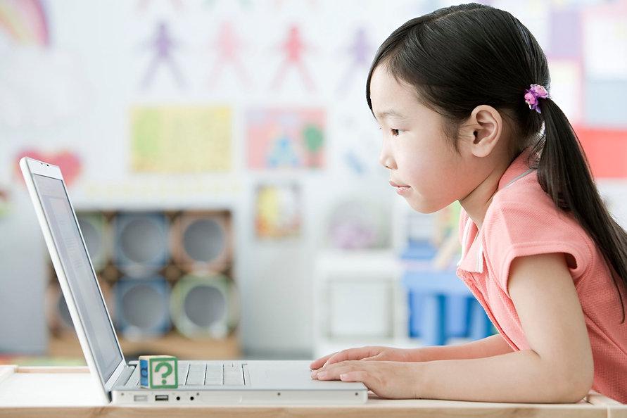 79065316-A-girl-using-a-laptop.jpg