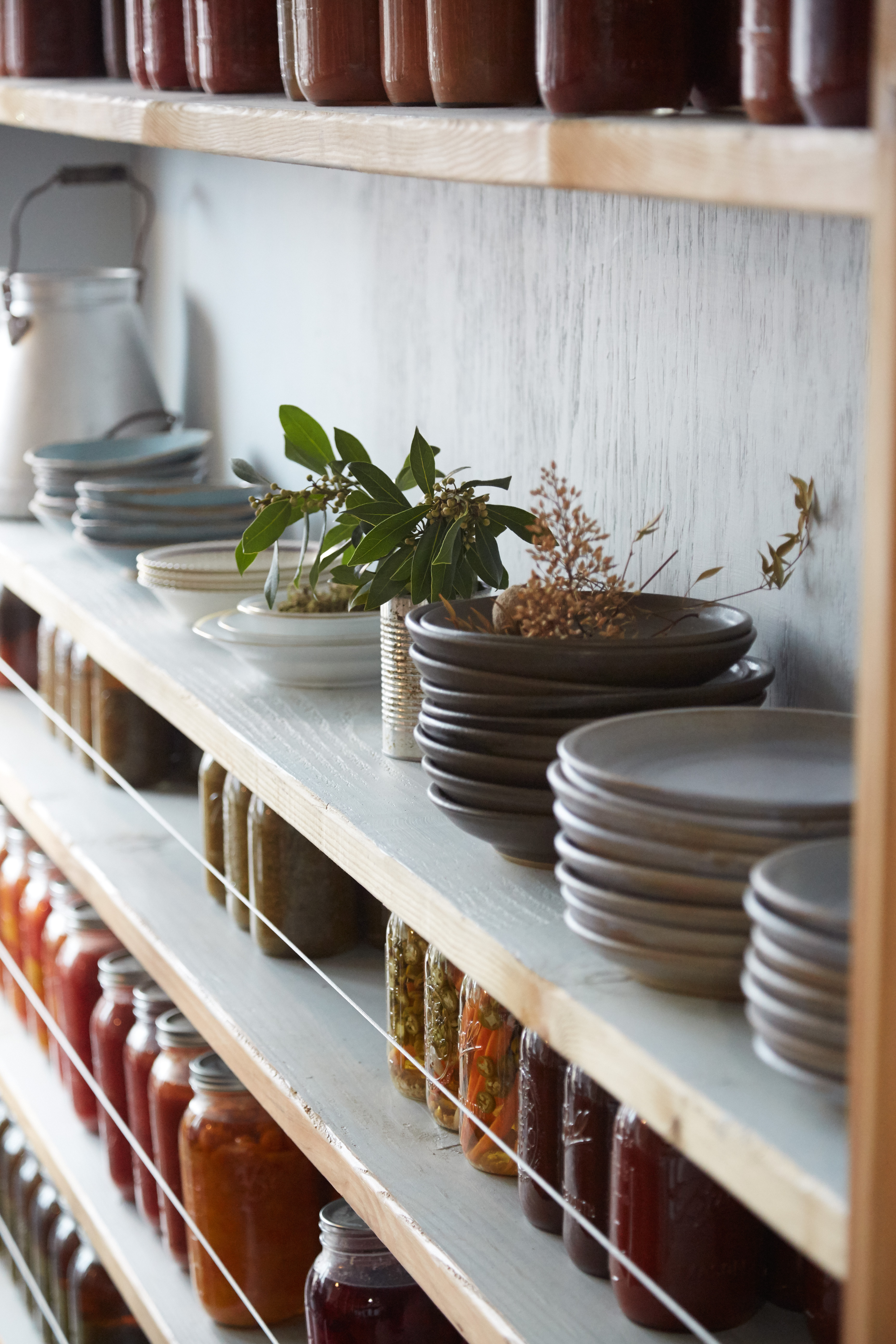 hand made plates and preserve shelf