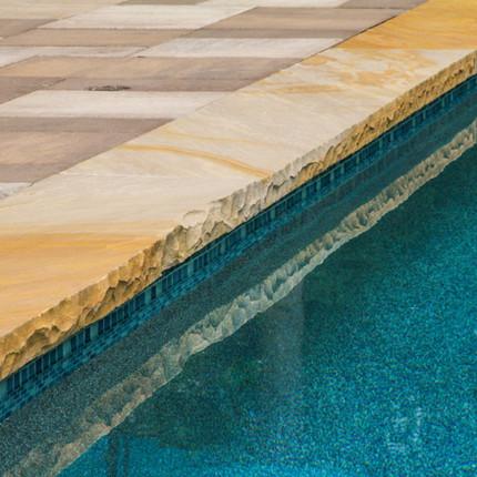 Sleek modern look around pool in Sedgefield