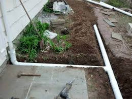 Gutters buried underground with smooth wall pipe