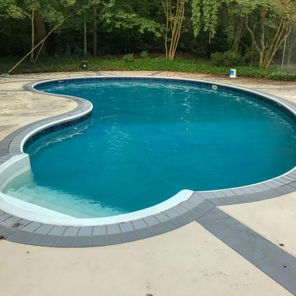BEFORE-Sleek modern look around pool in Sedgefield