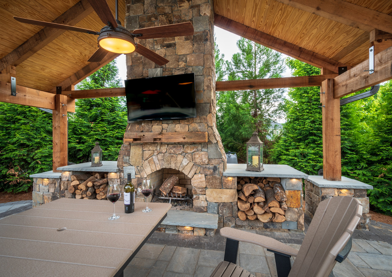 Custom Fireplace, Natural Stone Veneer and Covered Area