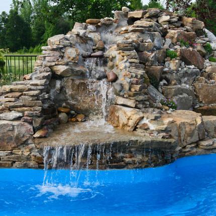 Custom Waterfall,Belgard pavers, coping, landscaping, irrigation, koi pond