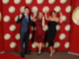 group-posing-for-a-photograph-and-the-woman-on-the-middle-holding-an-award