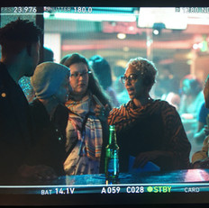 Marta discussing a scene with Issa Rae and crew on set of Insecure Season 2 EP 3