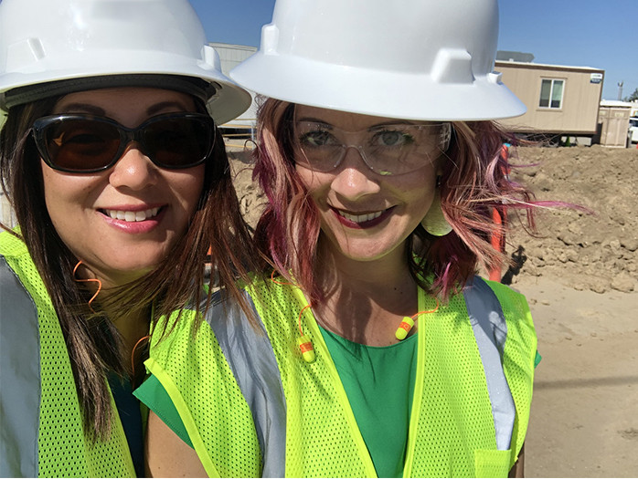 Dixie Casasola and Amy Noble, proposal consultants, on site at construction site for RFP
