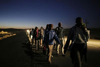 605769-african-migrants-walk-on-a-road-a
