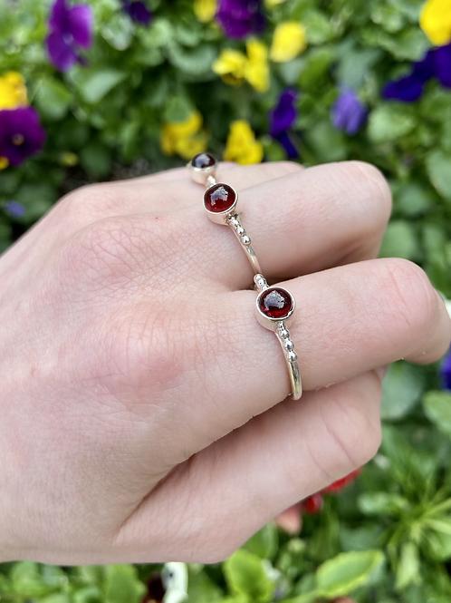 Sphere of Passion Garnet Ring