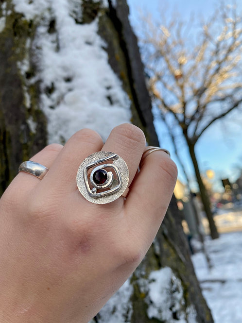 Abstract Garnet Shield Ring