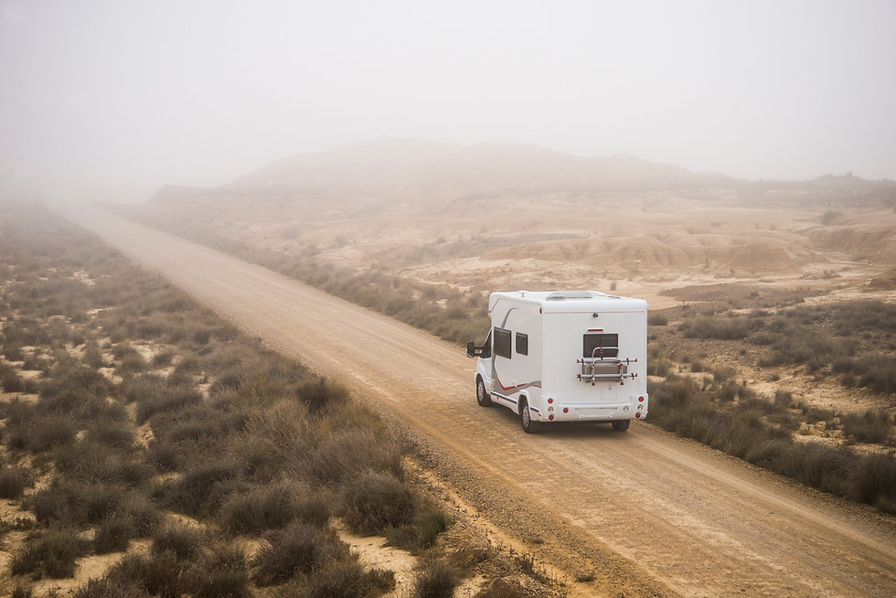 an RV on a dirt road - happy campers RV rentals