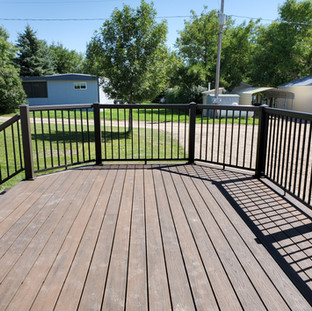 Decking: Trex Transcends in Rope Swing Railing: Regal Rail in Yard Bronze