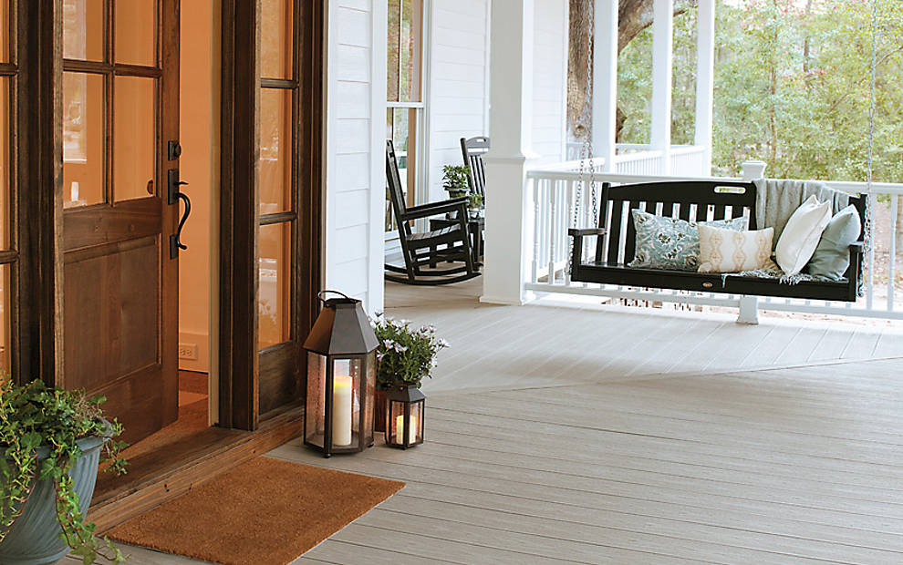 trex-transcend-porch-gravel-path-outdoor-furniture-black-swing-railing-classic-white-colonial-spindl