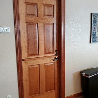 Cherry 6-panel door converted to a dutch door by the Front Street Millwork & Lumber millwork department.