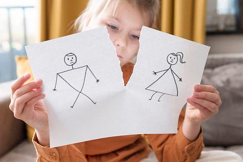 medium-shot-girl-holding-broken-drawing.