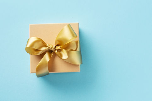 gift-box-with-golden-ribbon-bright-backg