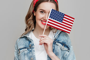 girl-holds-small-american-flag-smiles-is