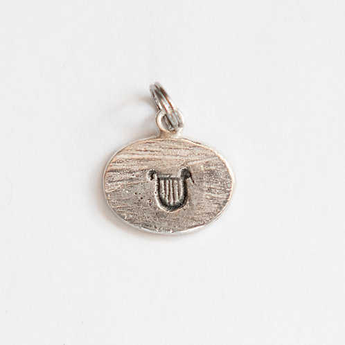 Lyre of Apollo Charm in sterling silver.