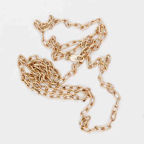 Small link charm chain in 14K yellow gold.