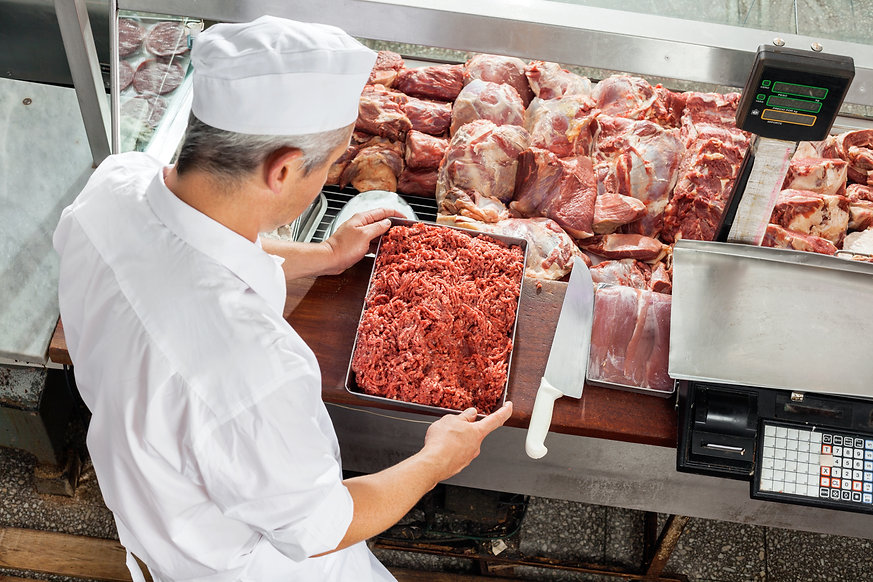 High angle view of butcher holding mince