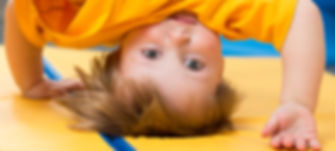 Baby Standing Upside Down On Gym Mat.jpg