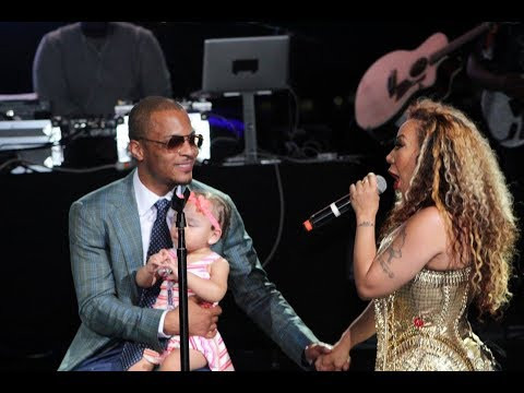 Tiny singing to her husband T.I. and baby Heiress.