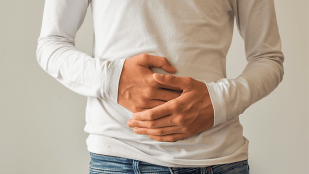 man-holding-stomach-with-both-hands-1280