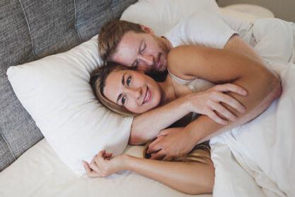 Smiling satisfied woman in bed.jpg