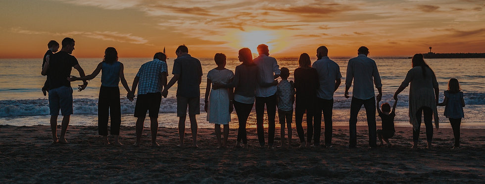 group of people in front of sunset