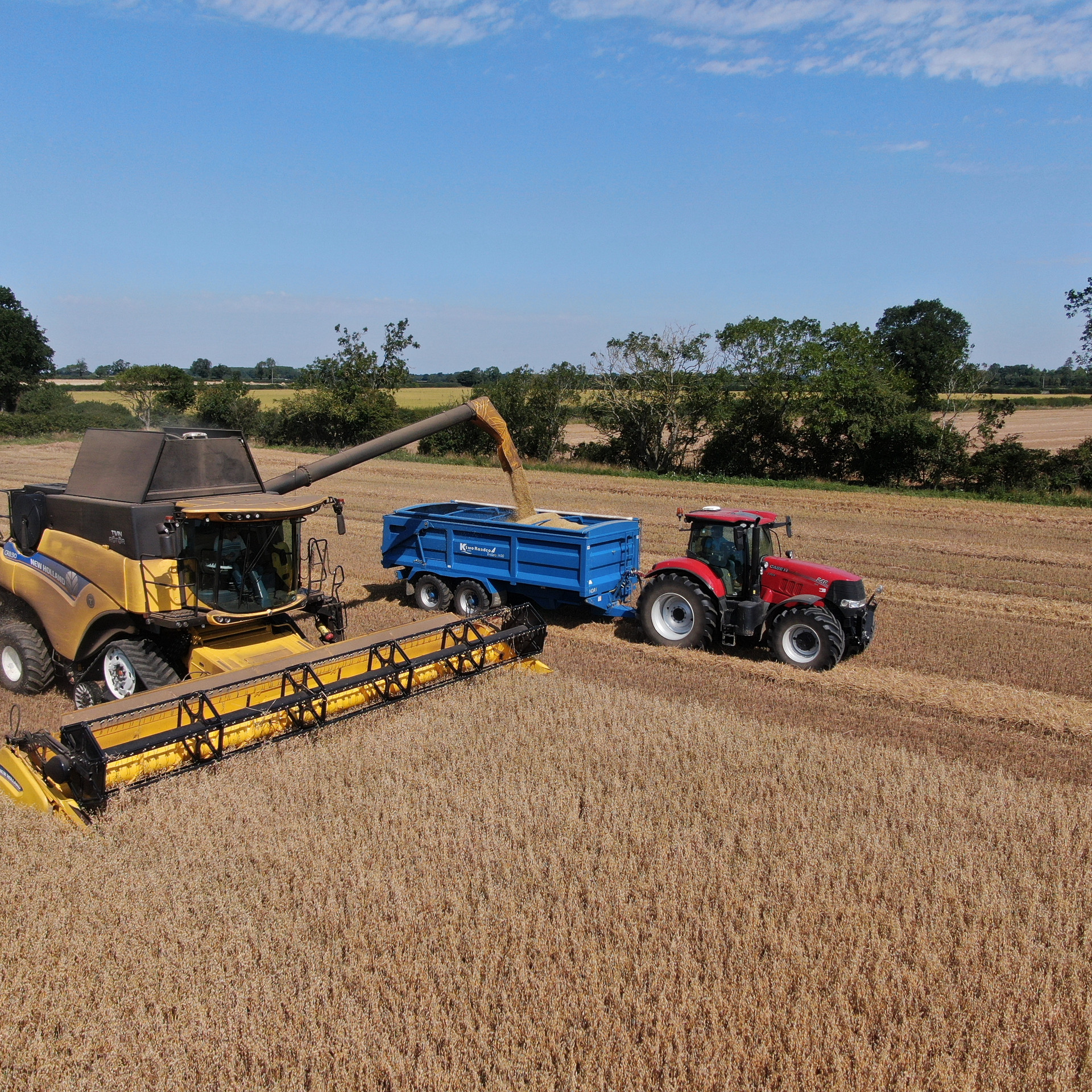 New Holland combine and Case IH Tractor