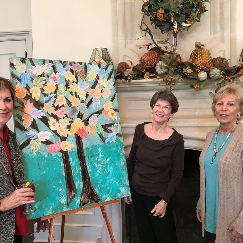 WFET Board members, Linda Spence, Alice Mercer, and Judy Penry, stand by the Advocacy Forum group painting.