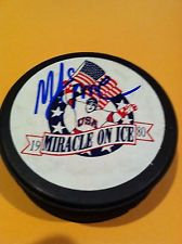 MIKE ERUZIONE SIGNED 1980 OLYMPIC HOCKEY SIGNED PUCK MIRACLE ON ICE