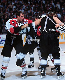 ERIC LINDROS FLYERS FIGHT PHOTO MCSORLEY