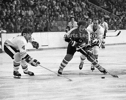 Bob Clarke Philadelphia Flyers vintage action 8x10 with Bobby Orr Bruins