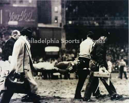 Frank Gifford carried on stretcher from hit by Eagles Chuck Bednarik