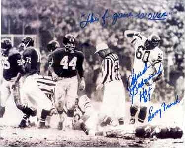 Chuck Bednarik signed standing over Frank Gifford 8x10 #2 1960 Eagles vs Giants