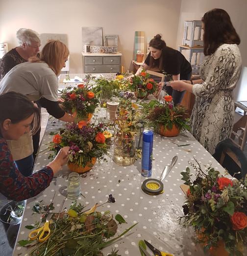 Floral autumn display in a pumpkin vase