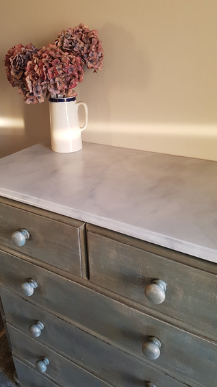 Chest of drawers with faux marble top