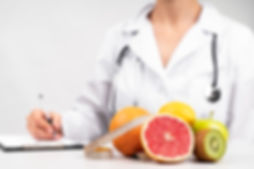 nutritionist-writing-healthy-fruit-snack