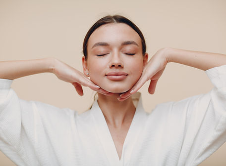 Young woman doing face building yoga facial gymnastics self massage and rejuvenating exerc