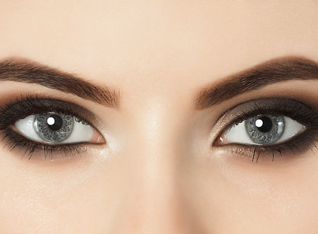 Beautiful woman with long eyelashes and with beautiful evening make-up. Eyes close up. Loo