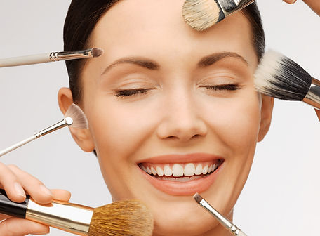 beauty and makeup concept - closeup portrait of beautiful woman getting professional make-
