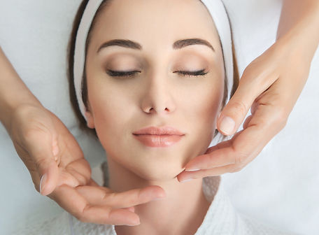 Face massage. Spa skin and body care. Close-up of young woman getting spa massage treatmen